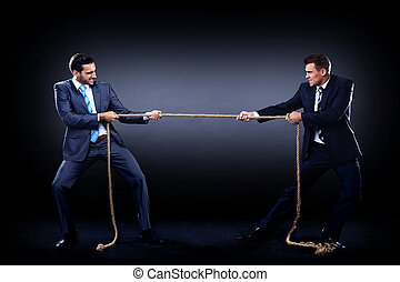 Two business men pulling rope in a competition, isolated on...