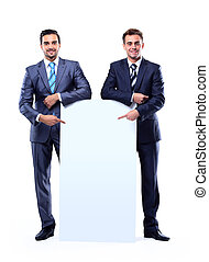 Two smiling business man showing blank signboard, isolated over white background