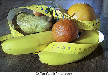 weight loss diet - conceptual image: fruit of the health and...