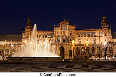 fountain on Plaza de Espana at night, Seville, Spain