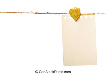 Clothes-peg in shape of heart isolated on white background