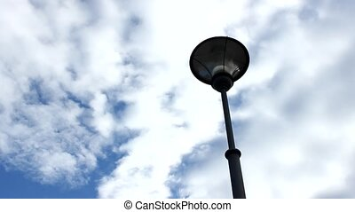 street lamp with clouds in winter time