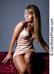 Beautiful young girl in a dressing gown with tanned skin