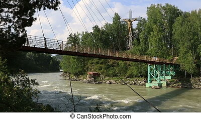 Suspension bridge between the islands on the Katun River...