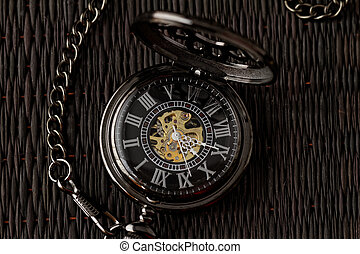Old watch machine on dark background