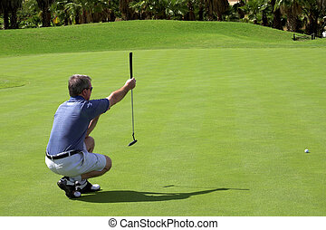 Golfer on the green - Golfer sitting down on the green,...