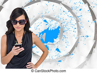 Composite image of happy brunette using smartphone -...