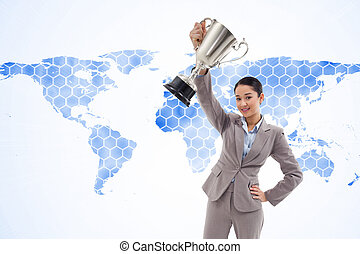 Composite image of businesswoman showing a cup - Composite...