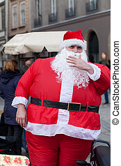 Very fat Santa Claus on the street of the city
