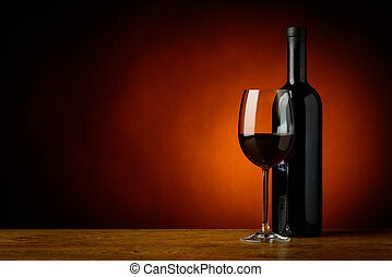 red wine - still life with glass and bottle of red wine and...
