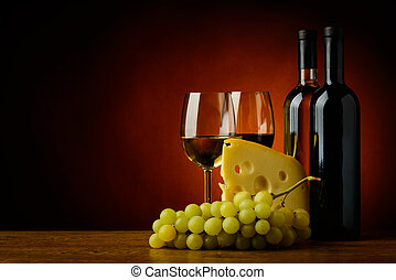 cheese, wine and grapes - still life with cheese, grapes,...