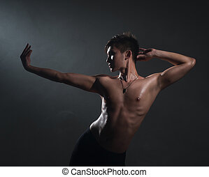 Man dancing ballet in studio