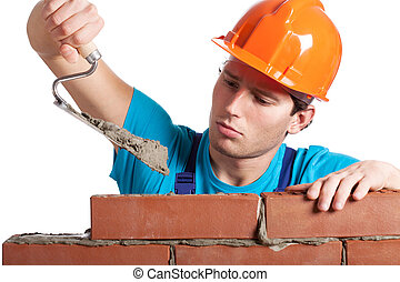 Constructor with putty knife building wall - Constructor...