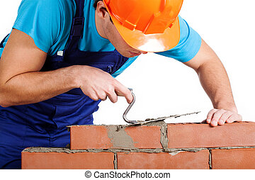 Handyman installing red brick - Handyman with trowel...