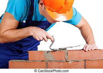 Handyman installing red brick - Handyman with trowel...