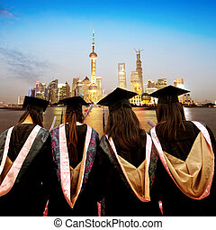 Graduates face skyscrapers in Shanghai's Lujiazui financial...
