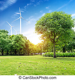 Wind farm - green meadow with Wind turbines generating...