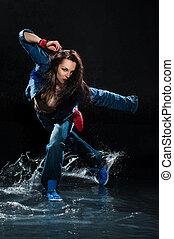 Wet dancing woman. Under waterdrops. Studio photo
