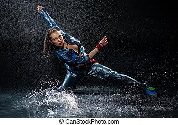 Wet dancing woman. Under water drops. Studio photo - Wet...