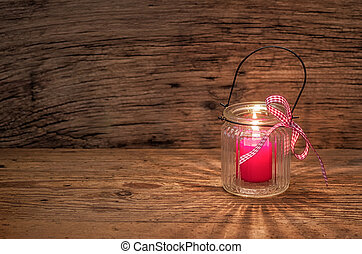 Candle on a wooden background