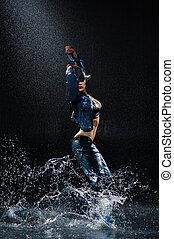 Wet dancing woman. Under water drops. Studio photo