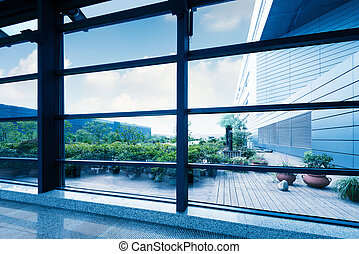 Office windows, modern building interior.