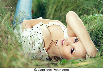 girl lying down of grass - beautiful girl lying down of...
