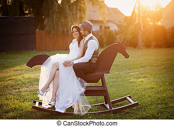 Bride and groom with a horse