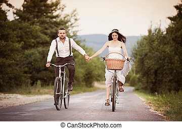 Bride and groom on the bikes - Beautiful bride and groom...