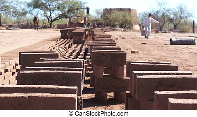 Adobe Brick Making Stacked - Long shot of a row of stacked...