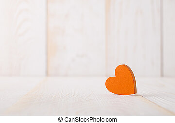 Heart. - Wooden colored heart ot the wooden background.