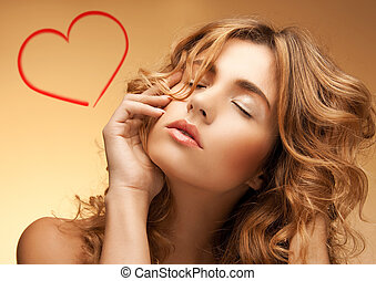 woman with long curly hair and closed eyes - health and...