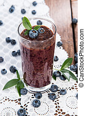 Healthy Blueberry Shake on wooden background