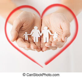 womans hands with paper man family - love, family and...