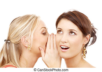 two smiling women whispering gossip - friendship, happiness...