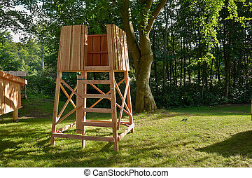 Hunter's box shooting stand in the forest - hunting image