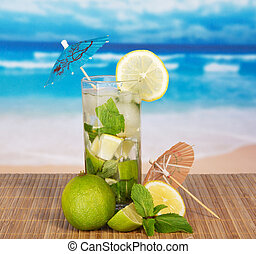 The cocktail glass, is decorated with umbrellas and a citrus...