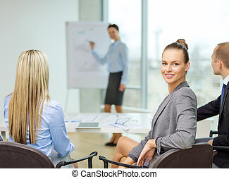 businesswoman with team showing in office - business and...