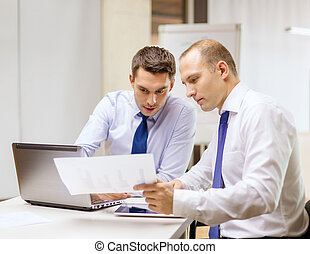 two businessmen having discussion in office - business,...