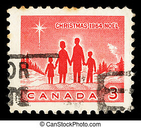 Christmas stamp printed in Canada shows Family and Star of...