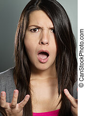 Young woman with a horrified expression - Close up of an...