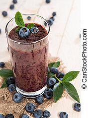 Blueberry Juice - Blueberry juice with fresh fruits on wood