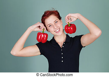 happy woman holding two pepper bells - happy redhead woman...