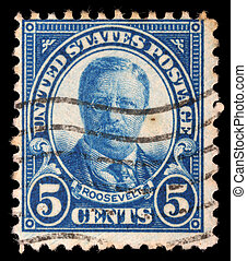 A stamp printed in the USA shows image of President Theodore...