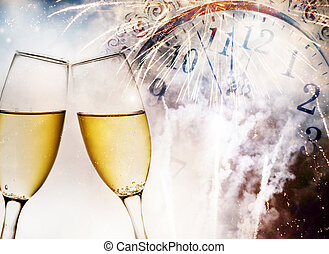Glasses with champagne against fire