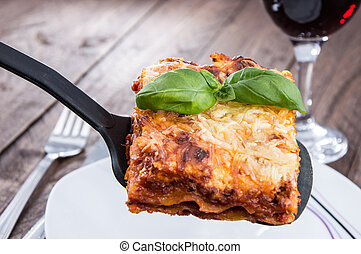 Homemade Lasagne on wooden background