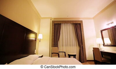 interior of hotel room - double bed and a lamp in the hotel...