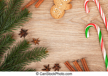 Christmas fir tree, gingerbread cookie and candy cane on...