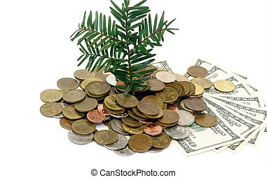 Money Growth Concept - Plant rising from a pile of golden...