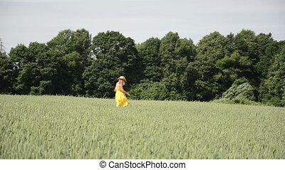 wheat field woman walk